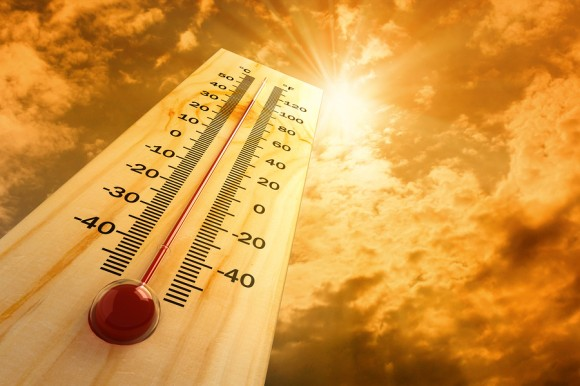 Thermometer under the sun in a hot day, showing high temperatures